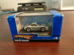 Hot Wheels: Black Porsche Cayman 1:87:scale in Collector's C